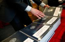 The White House Fiscal Year 2018 budget is placed on tables by House staff members in Washington